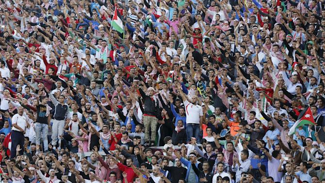 Jordanian fans cheer for their team during the 2018 World Cup qualifying soccer match against Australia in Amman