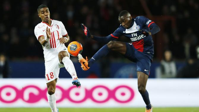 Paris St Germain's Matuidi challenges Lille's Beria during their French Ligue 1 soccer match in Paris