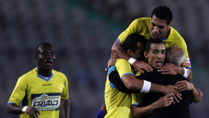 El Ismaily's Hassan celebrates with his coach Ahmed El Agouz after scoring a goal against El Zamalek during their opening Egyptian Premier League derby soccer match at Cairo Stadium