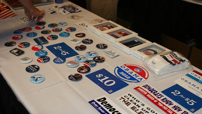 Vendors sell buttons and bumper stickers in the arena at the Democratic National Convention on Thursday Sept. 6, 2012. (Torrey AndersonSchoepe/Yahoo! News)