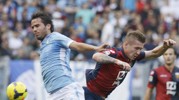 Lazio midfielder Alvaro Gonzalez of Uruguay, left, and Genoa midfielder Juraj Kucka of Slovakia fight for the ball during a Serie A soccer match between Lazio and Genoa, at Rome's Olympic stadium, Sunday, Nov. 3, 2013