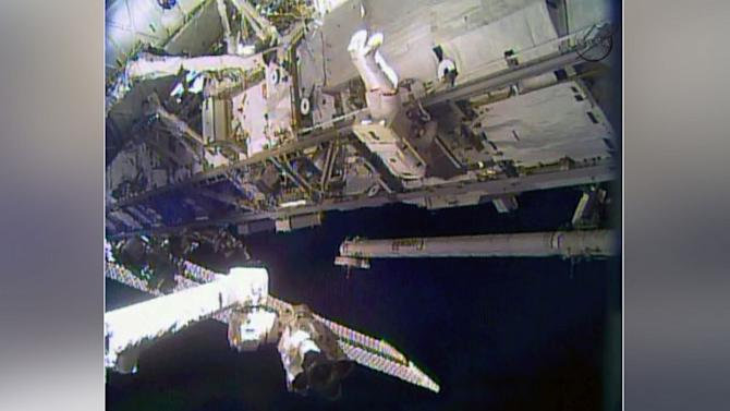 Astronauts Repair Space Station on Christmas Eve Spacewalk