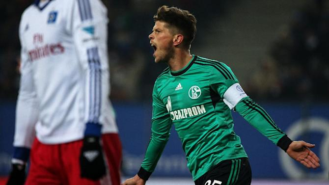 Schalke's  Klaas Jan Huntelaar celebrates a goal during the German Bundesliga soccer match between Hamburger SV and Schalke 04 in Hamburg, Germany, Sunday Jan. 26, 2014