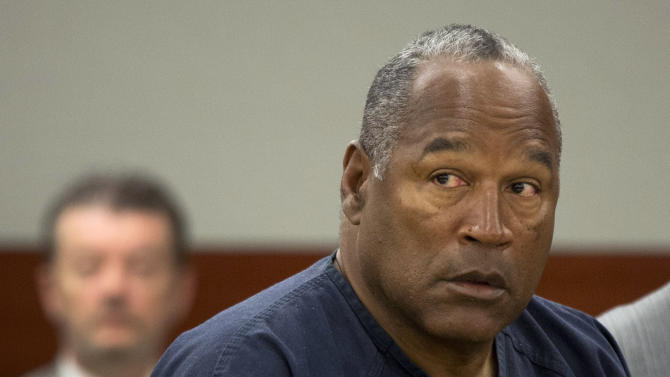 FILE - In this May 16, 2013 file photo, O.J. Simpson listens during an evidentiary hearing in Clark County District Court, Thursday, May 16, 2013 in Las Vegas. Simpson has a hearing before the state parole board Thursday, July 25, 2013, but even a favorable decision won't spring him from prison for his kidnapping and robbery convictions. He was sentenced consecutively on several charges so he would still have more time to serve. (AP Photo/Julie Jacobson, Pool, File)