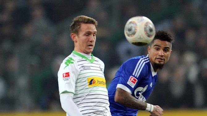 Schalke's Kevin-Prince Boateng, right, and Gladbach's Luuk de Jong challenge  for the ball during the Bundesliga soccer match between Borussia Moenchengladbach and FC Schalke 04 at Borussia Park in Moenchengladbach, Germany, Saturday Dec. 7, 2013