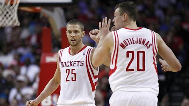 Houston Rockets small forward Chandler Parsons (25) and power forward Donatas Motiejunas (20) (Reuters)