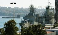 """Australian Navy ships docked at the Garden Island Naval Dockyard, near Sydney. Australian Treasurer Wayne Swan declared the """"deficit years of the global recession"""" over Tuesday, unveiling a Aus$1.5 billion budget surplus funded by deep cuts to defence and foreign aid spending"""