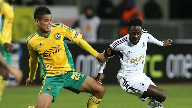 Swansea City's Nathan Dyer, right, vies for a ball with Kuban Krasnodar's Lorenzo Melgarejo during their Europa League group A soccer match at a stadium in Krasnodar, Russia, Thursday, Nov. 7, 2013