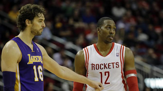 Los Angeles Lakers' Pau Gasol (16) reaches out to Houston Rockets' Dwight Howard (12) after fouling him during the fourth quarter of an NBA basketball game Thursday, Nov. 7, 2013, in Houston. The lakers won 99-98
