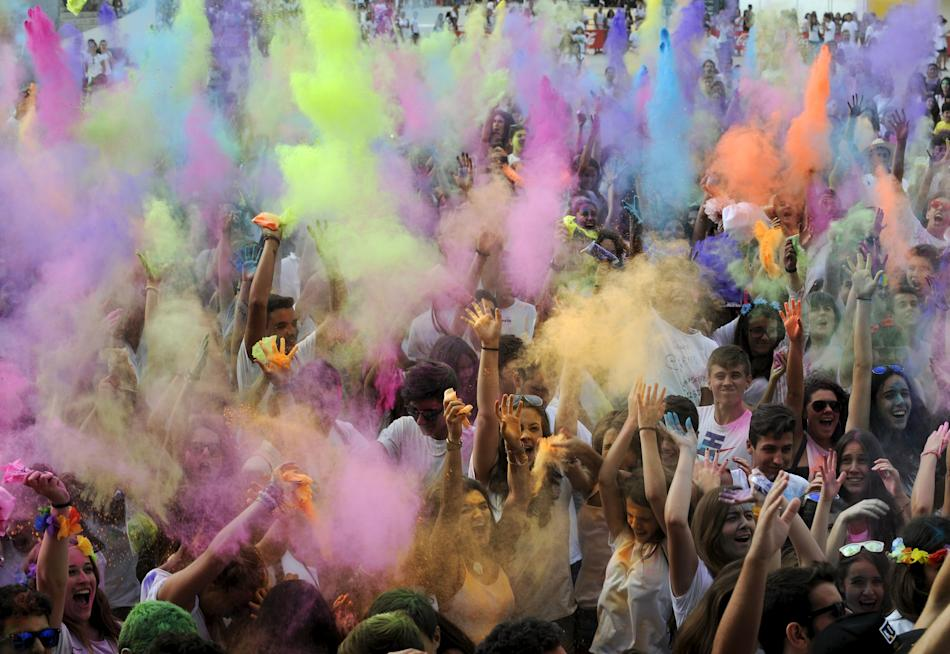 Revellers take part in the Holi Party Festival at the Niemeyer Center in Aviles