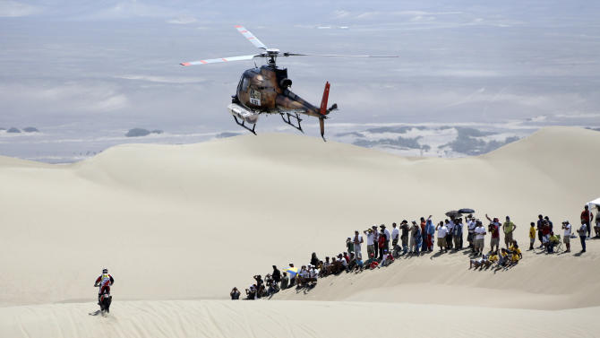 Spain's Guell Gerard Farres rides his Honda motorcycle during the first stage of the Dakar Rally 2013, from Lima to Pisco