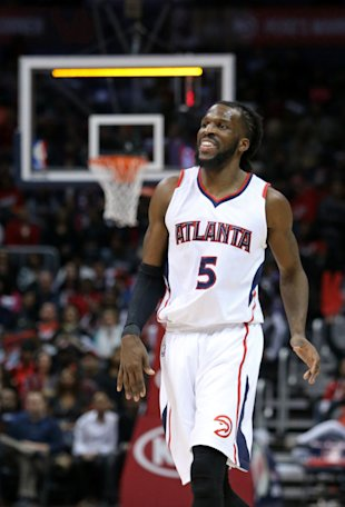 DeMarre Carroll has reason to smile. (Jason Getz-USA TODAY Sports)