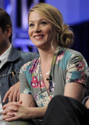 "FILE - This Aug. 1, 2011 file photo shows actress Christina Applegate, a cast member in the television series ""Up All Night,"" taking part in a panel discussion on the show at the NBC Universal summer press tour in Beverly Hills, Calif. Applegate, 40, was diagnosed with breast cancer at age 36 and underwent a double mastectomy. To help raise money during Breast Cancer Awareness month for her Right Action for Women charity, Applegate will wear the sneakers, headbands and jog bra that sportswear brand ASICS has made as fundraising items in a special-edition partnership. The items are on sale through Oct. 31. (AP Photo/Chris Pizzello, file)"