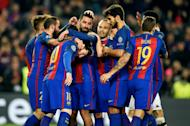 Barcelona's Arda Turan (C) celebrates with teammates after scoring a goal during their UEFA Champions League Group C match against Borussia Moenchengladbach, at the Camp Nou stadium in Barcelona, on December 6, 2016