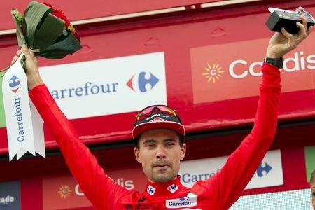 Giant-Alpecin Team rider Dumoulin of the Netherlands celebrates on the podium after winning the 17th stage individual time trial of the Vuelta Tour of Spain cycling race in Burgo