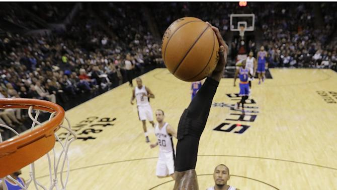 New York Knicks' Iman Shumpert goes in for a basket as San Antonio Spurs' Boris Diaw watches during the first half on an NBA basketball game, Thursday, Jan. 2, 2014, in San Antonio. (AP Photo/Eric Gay)