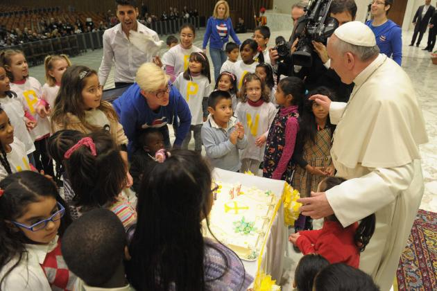 Pope Francis blows a candle on a cake during an audience with children assisted by volunteers of Santa Marta institute in Paul VI hall at the Vatican