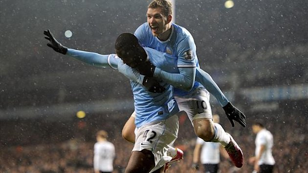 Manchester City's Yaya Toure celebrates with his team-mates after scoring his team's third goal