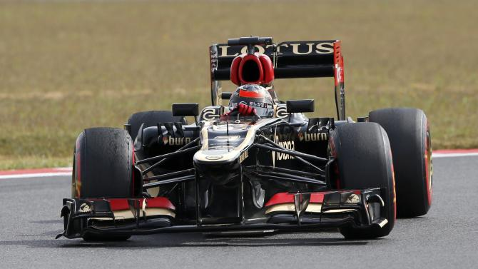 Lotus Formula One driver Raikkonen drives during the qualifying session for the Korean F1 Grand Prix in Yeongam