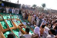 """A picture taken last August on a trip guided by the former Libyan government shows a mass funeral in the village of Majer as Libyan authorities accused NATO of a """"massacre"""" of 85 villagers in air strikes. NATO's bombing campaign in Libya left 72 civilians dead last year, Human Rights Watch says, accusing the military alliance of failing to acknowledge the deaths"""