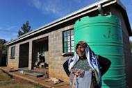 Mampai Lesgapa, 62, stands in front of her home in the village of Ha Seoehlana in May 2012. Lesgapa was resettled for the Mohale Dam in 2002