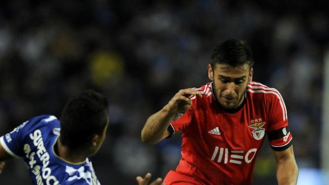 FC Porto's Alex Sandro, left, from Brazil challenges Benfica's Eduardo Salvio from Argentina, in a Portugal Cup semifinal first leg soccer match at the Dragao stadium in Porto, Portugal, Wednesday, March 26, 2014