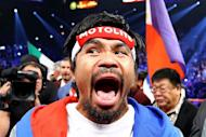 Manny Pacquiao, pictured before taking on Juan Manuel Marquez in their welterweight bout at the MGM Grand Garden Arena, on December 8, in Las Vegas, Nevada