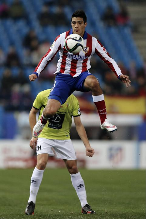 Atletico's Raul Jimenez from Mexico, jumps for the ball during a King's Cup soccer match between Atletico de Madrid and Hospitalet, at the Vicente Calderon stadium in Madrid, Spain, Thursday,