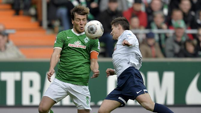 Bremen's Clemens Fritz, left, and Freiburg's Vaclav Pilar of Czech Republic challenge for the ball during the German first division Bundesliga soccer match between Werder Bremen and SC Freiburg in Bremen, Germany, Saturday, Oct. 19, 2013