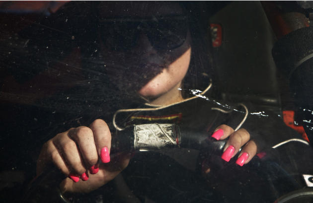 Rookie race driver O'Reilly sports her good luck pink fingernails while waiting to take part in qualifying in the Streets stock car category at Agassiz Speedway in Agassiz