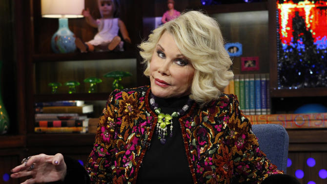 """FILE -  This Feb. 16, 2012 file photograph originally released by Bravo shows Joan Rivers appearng on Bravo's """"Watch What Happens Live"""" show on  in New York. Police were called to a Costco store in a Los Angeles suburb after comedian Joan Rivers handcuffed herself to a shopping cart to protest the store, which is not selling her latest book. The 79-year-old """"Fashion Police"""" host was being filmed by a camera crew Tuesday, Aug. 7, as she complained that the store in Burbank, Calif., had refused to carry her book, """"I Hate Everything... Starting With Me."""" Burbank city spokesman Drew Sugars says the store manager called police, who sent officers to the scene because they were uncertain of the scale of the situation. They ended up escorting Rivers from the store, and she and her crew left without incident. Sugars says there were no citations or arrests. (AP Photo/Bravo, Peter Kramer, file)"""
