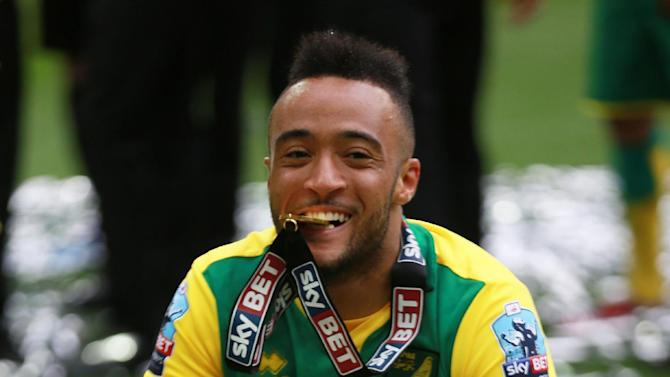 Football: Norwich City's Nathan Redmond celebrates with the trophy after gaining promotion to the Barclays Premier League