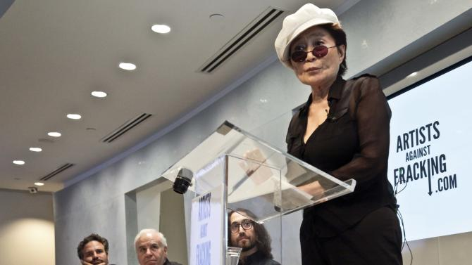 """Actor and activist Mark Ruffalo, far left, Cornell University engineering professor Anthony Ingraffea, second from left, and Sean Lennon, second from right, listens as Yoko Ono speaks during a press conference to launch a coalition of artists opposing hydraulic fracturing on Wednesday, Aug. 29, 2012 in New York. The formation of the group, called Artists Against Fracking, comes as New York Gov. Andrew Cuomo decides whether to allow shale gas drilling using high-volume hydraulic fracturing called hydrofracking. The group says such drilling is harmful and poses the threat of contamination. They say they want to spread awareness of the issue through """"peaceful democratic action.""""  Cuomo is expected to allow drilling to begin on a limited basis near the Pennsylvania border.  The group is comprised of 146 members including Lady Gaga, Paul McCartney and Alec Baldwin. (AP Photo/Bebeto Matthews)"""