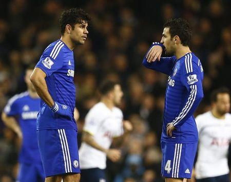 Chelsea's Diego Costa and Cesc Fabregas react after Tottenham Hotspur's fourth goal during their English Premier League soccer match at White ...