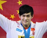 China's gold medalist Sun Yang celebrates after taking a gold medal at the FINA World Championships in July 2011. China has announced a team of 396 athletes for the London Olympics, including Sun, who is tipped to become China's first Olympic male swimming champion