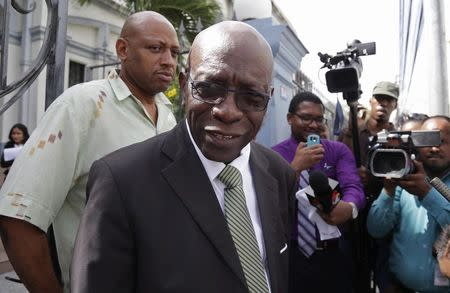 Former FIFA vice-president Jack Warner talks to the media in Port of Spain