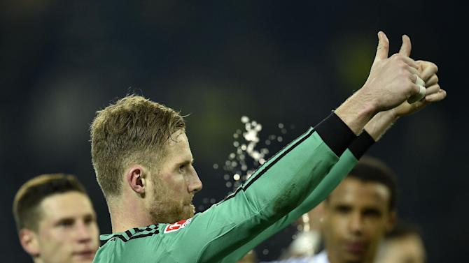 Schalke goalkeeper Ralf Faehrmann thanks supporters after the German Bundesliga soccer match between Borussia Dortmund and FC Schalke 04 in Dortmund,  Germany, Tuesday, March 25, 2014
