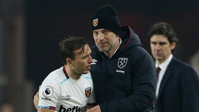 West Ham United's Mark Noble is congratulated by manager Slaven Bilic as he is substituted