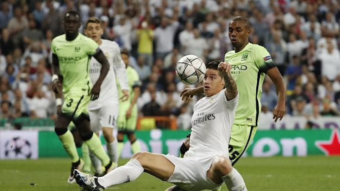 Real Madrid's James Rodriguez in action with Manchester City's Fernandinho