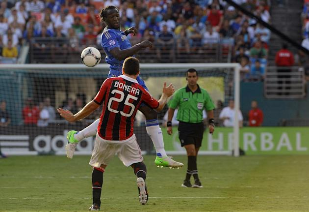 COMMERCIAL IMAGE - In this photograph taken by AP Images for Herbalife, Chelsea FC player Romelu Lukaku heads the ball while being defended by A.C. Milan player Daniele Bonera (25) during the first ha