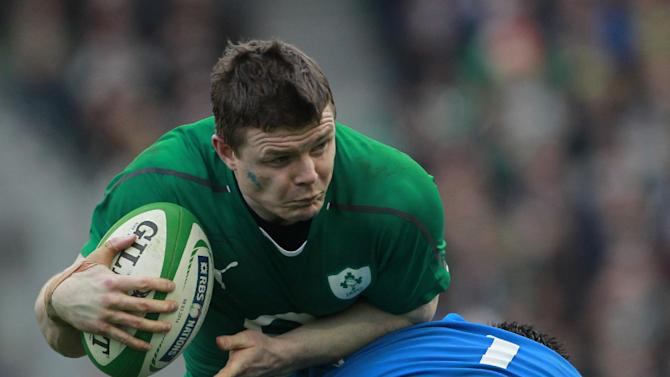 Ireland's Brian O'Driscoll, left, is tackled Italy's Alberto De Marchi during their Six Nations Rugby Union international match at the Aviva Stadium, Dublin, Ireland, Saturday, March 8, 2014. (AP Photo/Peter Morrison)