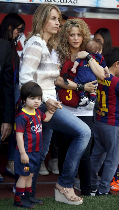 Singer Shakira holds her son Sasha next to her son Milan and mother-in-law Montse before the Spanish first division soccer match between Barcelona and Valencia at Camp Nou stadium in Barcelona