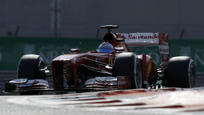 Ferrari Formula One driver Alonso of Spain drives during the third practice session of the Abu Dhabi F1 Grand Prix at the Yas Marina circuit on Yas Island