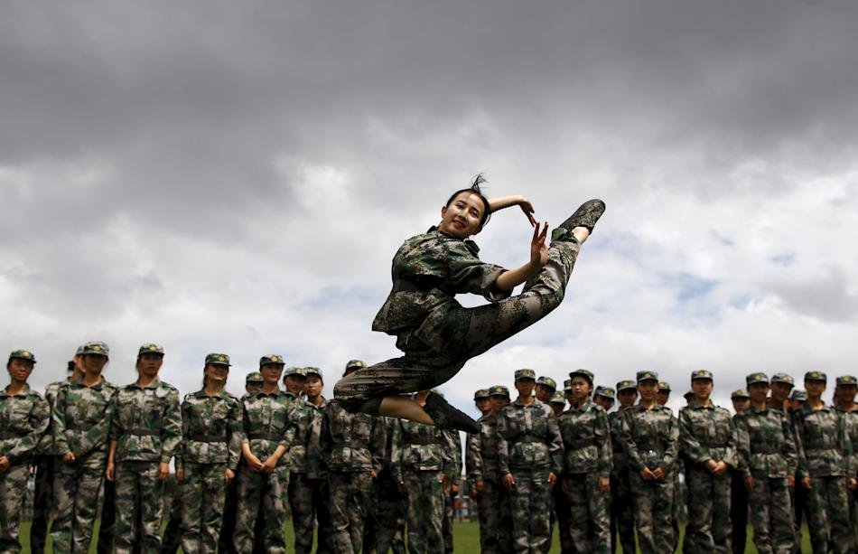 Student dances as she performs for her fellow students while they take a break from their military training in Kunming