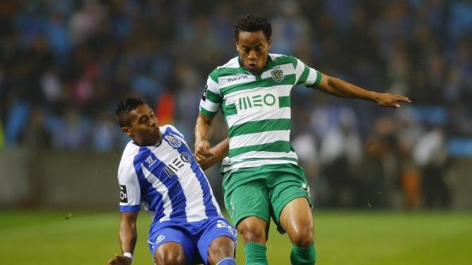 Porto's Alex Sandro fights for the ball with Sporting's Carrilo during their Portuguese Premier League soccer match at Dragao stadium in Porto