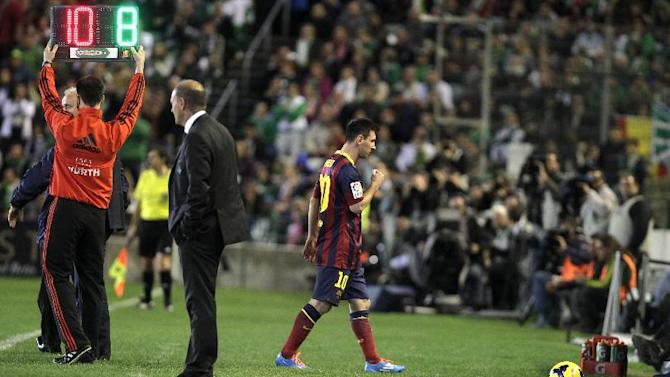 Barcelona's Lionel Messi from Argentina is substituted during their La Liga soccer match at the Benito Villamarin stadium, in Seville, Spain, Sunday, Nov. 10, 2013