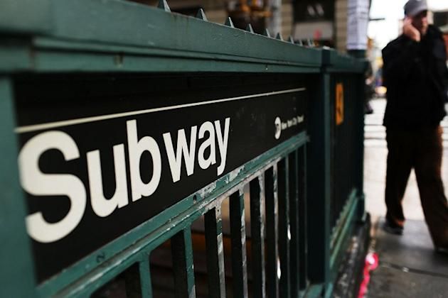 A man walks past a subway stop in Manhattan on December 5, 2012 in New York City. A 31-year-old New York woman was scheduled to appear before a judge Sunday after being charged with murder as a hate crime for shoving a Hindu man to his death in front of an oncoming subway train
