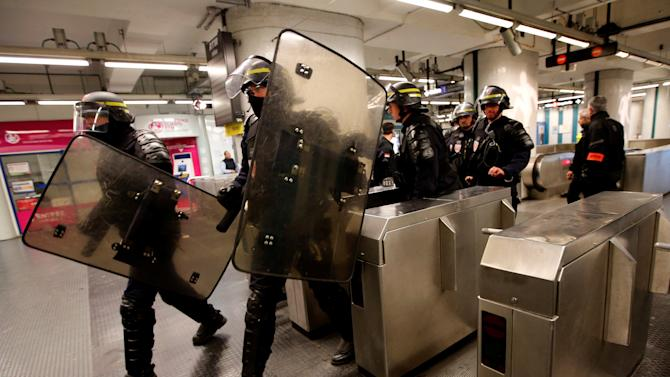 French riot policemen attend a drill at the Marseille railway station