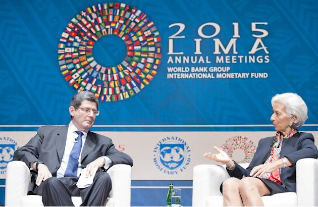 Brazil's Finance Minister Joaquim Levy along with International Monetary Fund Managing Director Christine Lagarde participate in a Seminar on Global Economy as part of the 2015 IMF/World Bank Annu