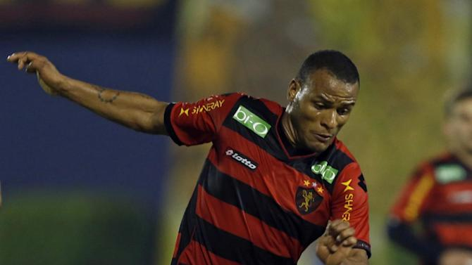 Patric, of Brazil's Sport Recife, top, fights for the ball with Luis Amarilla, of Paraguay's Libertad, during a Copa Sudamericana soccer game in Asuncion, Paraguay, Wednesday, Sept. 25, 2013